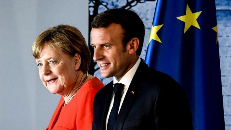 Encontro entre Merkel e Macron [Foto: Lusa/EPA]