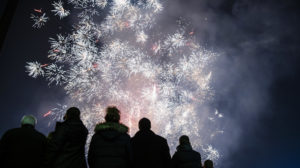 Bulgarians watch fireworks explode during New Year celebrations in central Sofia early on January 1, 2018.  / AFP PHOTO / Dimitar DILKOFF
